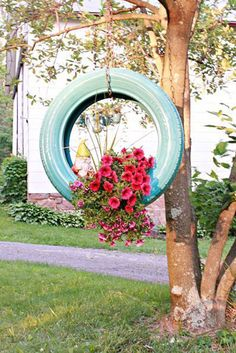Craft a colorful planter out of an old tire by using spray paint, a chain and a hook.