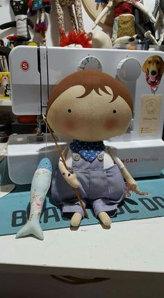 little boy doll, with fishing line and fish!