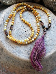 Mala made of 108, 7/8 mm - 0.275/0.315 inch, very beautiful shell gemstones and decorated with faceted cherry quartz, faceted garnet and hematite