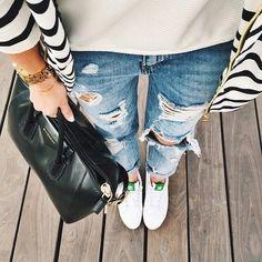 distressed denim + givenchy bag + white adidas