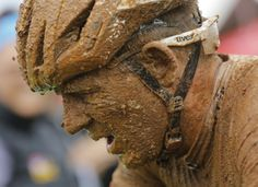 Karl Platt from Bulls racing is covered in mud after heavy overnight rain turned the trail into mud during stage 2 of the annual ABSA Cape Epic mountain bike stage race, Cape Town, South Africa, March 25 2014. The multi day stage race is know as the 'Tour de France' of mountain biking and sees 1200 riders riding 720km in 7 days. The race includes the worlds leading professional racers along with amateur cyclists.  More photos: http://on.thestar.com/1g0pjq6