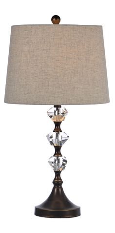 Catch your visitor's eye with the Bronze Crystal Table Lamp. The bronze finish, stacked crystal orbs and dark oatmeal shade create a piece that is both sophisticated and stunning. Buy it on sale now for just $39.99. Sale ends 7/24.