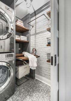 I just love this industrial laundry room with pipe shelving and wooden shelves