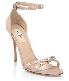 """glam ankle-strap sandals by Valentino. Chic ankle strap sandals with rock stud detailing. Stiletto heel, 4.13"""" (105mm).Viscose/silk upper. Open toe. Adjustable ankle strap. Leather lining. Leather sole. Made in Italy. #valentino #nudeshoes #sandals #anklestrapsheelschic"""