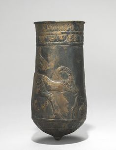 The metalworkers of Luristan provided the Assyrian empire with elaborate bronze ornaments and vessels. These two situla are decorated symmetrically---one with ibexes drinking from an overflowing Fall Of Constantinople, Achaemenid, Ancient Persia, Ancient Mesopotamia, Cleveland Museum Of Art, Iranian Art, Roman History, Bronze, Steel Sculpture