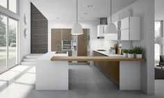 Modern kitchen cabinets from the Aran Cucine Miro Colours collection. Custom designed and installed by our experts. Call for a free consultation.
