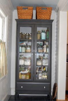 Pantry Conversion - idea for repurposing an old gun cabinet - (via chateauandbungalow)