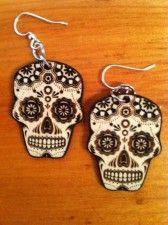 Wooden skull earrings. $16