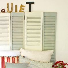 Shutter headboards are nothing new, but the letters add a great touch of quirky sophistication