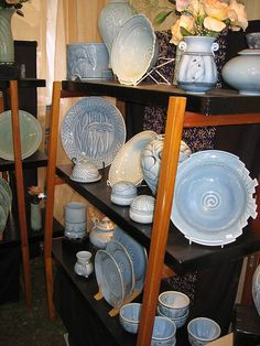 linda heisserman carved pottery nouveau lines display craft fair booth ceramics clay