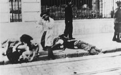A man beats a woman in the Romanian city of Iaşi during a pogrom that left over 13,000 Jews dead.
