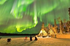 Northern lights above night in Yellowknife, Canada. Photo by: Kwon O. Chul--These 12 Amazing Photos Will Make You Go Camping