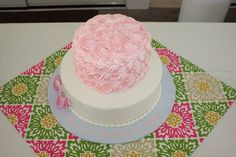 My pink raspberry swirl sweet 16 cake with rose and bow detailing.