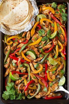 Chicken fajitas that don't need anything but tortillas the ingredients that bake on the pan. | 30-Minute Sheet Pan Dinners For Busy Weeknights #ad