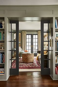 True to Form 1929 Farmhouse French pocket doors lead from the library to a cozy sitting room.French pocket doors lead from the library to a cozy sitting room. Style At Home, French Pocket Doors, Black French Doors, Double Pocket Door, Glass Pocket Doors, Sliding French Doors, Double Glass Doors, Doors With Glass Panels, French Doors Inside