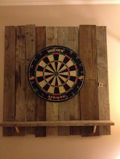 dart board backdrop made of pallet wood.