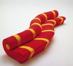 chiocciolin-chiocciolout 1972 Concave/convex seats composed in a neverending sofa,flexible polyurethane foam; removable cover in elastic or rigid fabric.
