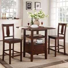 @Overstock - This Laurel 3-piece bistro seat brings traditional yet simple furniture styling into your dining decor. This bistro set features a drop down table leaf that works best for small dining areas.http://www.overstock.com/Home-Garden/Laurel-Dark-Walnut-3-piece-Bistro-Set/7210830/product.html?CID=214117 $320.39