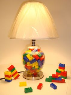 Lego lamp idea, this picture is not even using REAL LEGO, but I would, this random mix of basic LEGO colours is great for a kids room, but for an adult you could use more discreet matching shades.