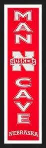 Framed University of Nebraska Huskers Man Cave banner.
