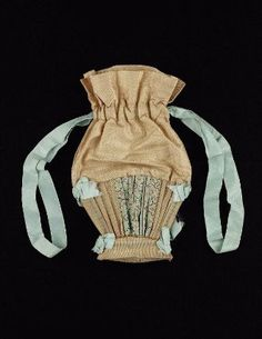 Drawstring bag, American, 1800-30. Bottom of bag shaped like basket and made of stiff deep cream colored mohair with minute blue figure, two panels of light blue painted silk moiré, upper part of bag of deep cream colored figured silk, blue silk ribbon drawstring and bows trimming lower part of bag - in the Museum of Fine Arts Boston.