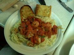 Tgi Friday s Copycat  Bruschetta Chicken Pasta from Food.com: My FAVORITE dish from TGIFriday's. I found the copycat and it is delicious. It is super simple to make and don't skimp on the garlic because that is what really makes the flavor. Also, if tomatoes aren't in season use the canned tomatoes in italian seasonings, they work just as well. Add some garlic bread to the side and you're done!