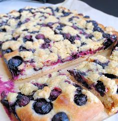 Sweet focaccia-style tea bread topped with blueberries and crumble.