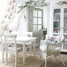 Beautiful and romantic dining room. Hemnes glass door cabinet, Ingolf chairs, Ingatorp dining table, Egeby Rugs