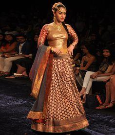 Neeta Lulla An elegant ghagra in deep maroon and gold brocade with a broad gold border. The ghagra comes with a gold sequin choli with full length brocade sleeves. A shaded silk dupatta completes the ensemble. Brocade Lehenga, Silk Dupatta, Sari, Neeta Lulla, Lehnga Dress, Gold Blouse, Indian Couture, Indian Fashion, Bridal