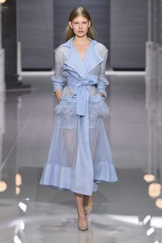 Sky blue silk gazar trench coat featuring detachable burnt Ostrich feather pockets.