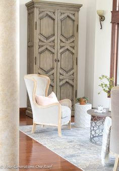 Spring is in the air! Our Spring Grand Foyer Decorating Ideas featuring gorgeous chairs, rug and rustic cabinet from HomeGoods (sponsored) #rusticmodern #modernrustic #decor #interiordesign #mediterranean #bhg #spring #decorating #foyer #springdecorating #rustic #rusticmodern #italiandesign #italianstyle #fixerupperstyle #fixerupper