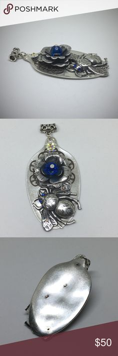 """Steampunk Pendant This is a unique handcrafted pendant. All components are mounted with bronze laser rivets to a flattened silver plated spoon. In the center of the silver plated flower is a 8mm faceted Swarovski Bead. Blue rhinestone eyes have been added to the sterling plated Bee. Measures approx 1 1/4"""" x 2 3/8"""".  Crafted by me in my studio. designsbysteve Jewelry Necklaces"""