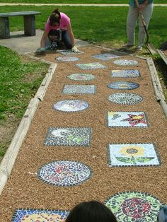 4th grade students took old worn out stepping stones, flipped them over, and mosaiked the top with recycled glass chips that we tumbled to remove sharp edges.