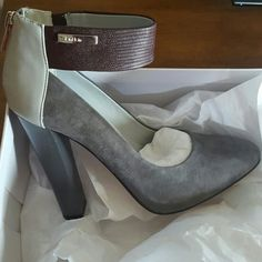 "Calvin Klein Ariel tri color leather heels NIB 5 Leather Imported Synthetic sole Heel measures approximately 3.75"" Platform measures approximately 0.50"" Suede, lizard, smooth and patent leathers textures collide in this show-stopping pump. Grey/Burgundy/Ash Grey  ❌NO TRADES  ❌NO LOWBALL OFFERS ❌NO NEGOTIATING OVER COMMENT, USE OFFER BUTTON Calvin Klein Shoes Heels"