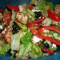 Ingredients   1 1/2 cups sun-dried tomato and oregano salad dressing   4 skinless, boneless chicken breast halves   2 red bell peppers, halved and seeded   1 head romaine lettuce - rinsed, dried, and torn into bite-size pieces   1 cup black olives, drained   4 ounces feta cheese, crumbled   1/2 cup sun-dried tomato and oregano salad dressing Marinate chicken 20-60 min in 1/2 C dressing. Grill grill peppers basting with 1/2 C dressing 1/2 C dressing over salad