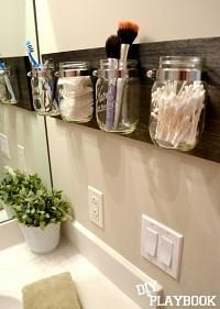 Mason Jar Organizer - smart use of space and jars that often end up in your recycling.   You don't have to use Mason Jars, why not try doing it with commercial pasta sauce, pickle or jam jars.  first.