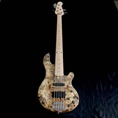 NEW USA Lakland 55-94 Deluxe Buckeye Burl Maple Custom with a birdseye maple fingerboard. Killer one of a kind top. Amazing wood. Great Birdseye maple fingerboard. The customs are unique hand selected custom bodies by Midlothian Music and here they are. Nine months wait for one bass to be manufac...