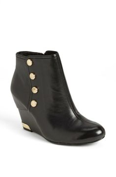 Button detail on bootie