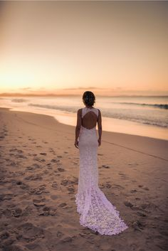 Samantha wears the Grace Loves Lace Alexandra gown.  Beach, wedding, sand, water, train, white, sunset, bride, wedding, beach wedding, footprints in the sand