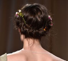 Guido peppered loosely-woven braids with summer-inspired sprigs, tucking daisies and baby's breath into the folds of models' hair.