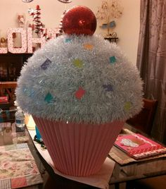 May 2016 - Cupcake card box. Base is made using a lamp shade that was spray painted. The cake was made from a paper mache ball and decorated with christmas garland and a giant red christmas ball Christmas Float Ideas, Christmas Parade Floats, Candy Land Christmas, Candy Christmas Decorations, Christmas Yard, Office Christmas, Christmas Gingerbread, Outdoor Christmas, Christmas Crafts