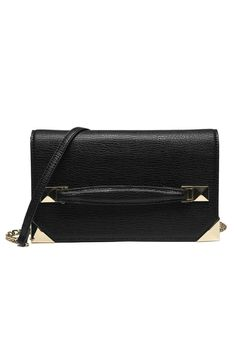 """Slim compact and up for anything thisclutch with gold tone metal details is the perfect date night accessory. Keep it close after dark by slipping your hand through the front strap. Magnet top flap closurefronthand strap interior slim pockets and gold chain shoulder strap.  Measures:10"""" x6"""" x2 1/2""""  Front Strap Clutch by Beth Friedman. Bags - Clutches Arizona"""