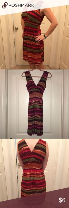 Multi color striped dress Multi color striped flowy dress  With elastic waste and stretchy material it is very comfortable and for hiding what you want to hide!  No tags inside for brand or size. But would suggest it is about a small / Medium Dresses