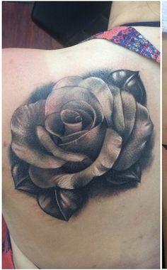 Love this black and white flower tattoo by Joe Matisa