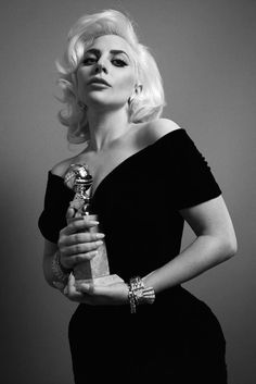 Lady Gaga with her Golden Globe awards