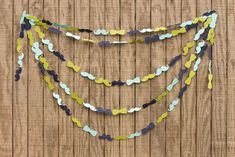 Mustache and bow tie garland used as a photo booth backdrop - adorable!