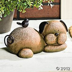 """Resting Dog Stone. Features a weathered stone-look finish. Resin. 9""""W."""