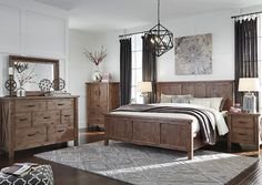 The popular Tamilo bedroom group can give your home the warm look it needs! Check it out at kemperfurnitureinc.com
