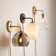 Sale ends soon. Shop Arren Wall Sconces with Shades. Bending gracefully from the wall, an iron base supports a sleek glass shade for a chic sconce at once modern and timeless. Plug In Wall Sconce, Black Wall Sconce, Wall Sconces, Bedroom Sconces, Wall Lamps, Bedroom Decor, Hanging Lights, Wall Lights, Ceiling Lights