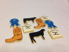 Boots and cows themed cookies.